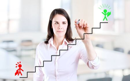 career ladder: Young businesswoman drawing the career ladder concept. Office background. Stock Photo
