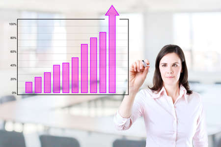 boomers: Young business woman writing over achievement bar chart. Office background. Stock Photo