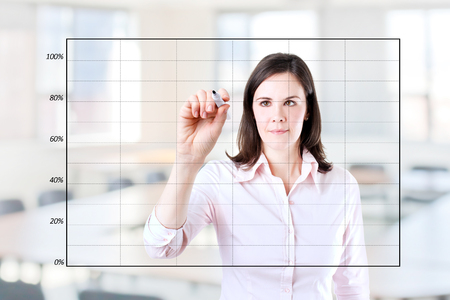 boomers: Young business woman drawing on empty graph. Office background. Stock Photo