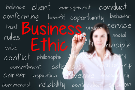 ethic: Business woman writing business ethic concept. Blue background.