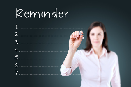 connotation: Business woman writing blank reminder list. Blue background. Stock Photo