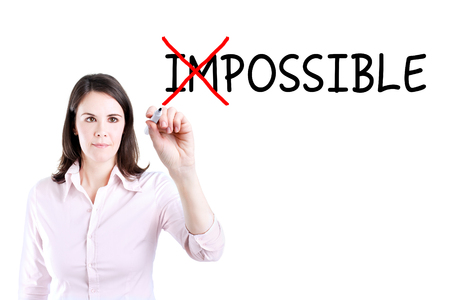 unachievable: Businesswoman Choosing INSTEAD OF Impossible Possible. Stock Photo