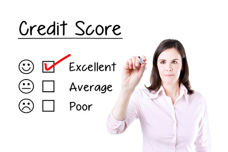 Hand putting the check mark with red marker on excellent credit score evaluation form.