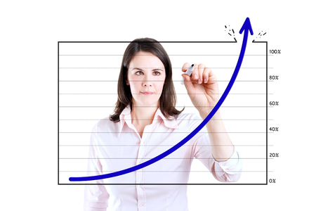 boomers: Young business woman drawing graph over target achievement. Isolated on white.