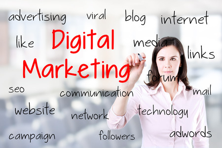 adwords: Business woman writing digital marketing concept. Office background.