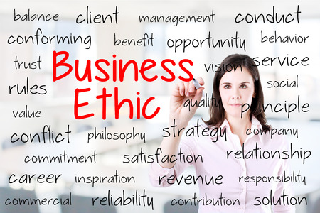 ethic: Business woman writing business ethic concept. Office background. Stock Photo