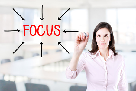 compile: Young business woman Focus on target. Office background.