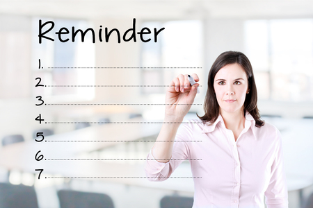connotation: Business woman writing blank reminder list. Office background.