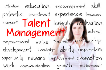 talent management: Business woman writing talent management concept. Isolated on white.