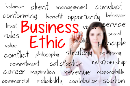 ethic: Business woman writing business ethic concept. Isolated on white.