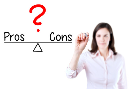 correlate: Young business woman writing pros and cons compare on balance bar. Isolated on white background.