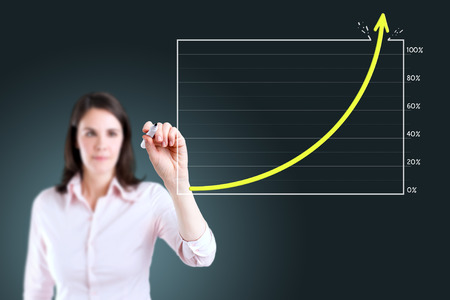 boomers: Young business woman drawing graph over target achievement. Stock Photo