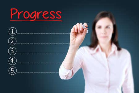 tweets: Business woman writing blank Progress list. Blue background.