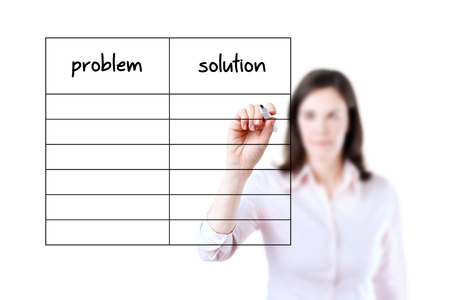 collate: Young business woman writing problem and solution listed in blank, white background.