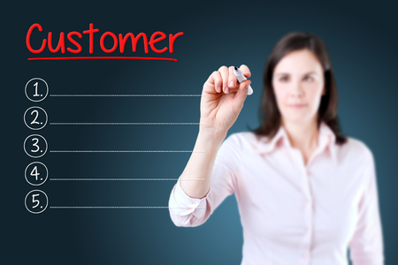 customer facing: Business woman writing blank Customer list. Blue background.