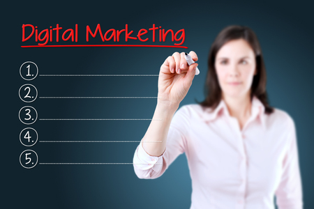 marketers: Business woman writing blank Digital Marketing list. Blue background.