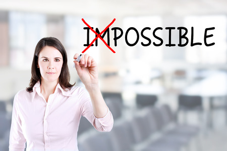 unachievable: Businesswoman Choosing INSTEAD OF Impossible Possible. Office background.
