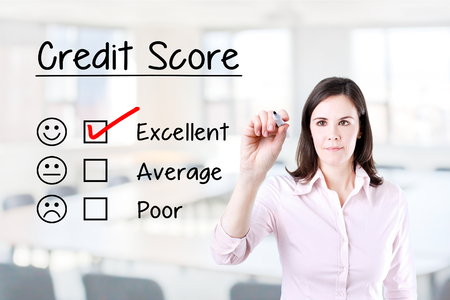 approval rate: Hand putting the check mark with red marker on excellent credit score evaluation form. Office background.