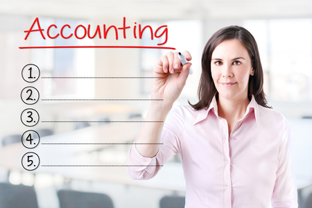 total loss: Business woman writing blank Accounting list. Office background.