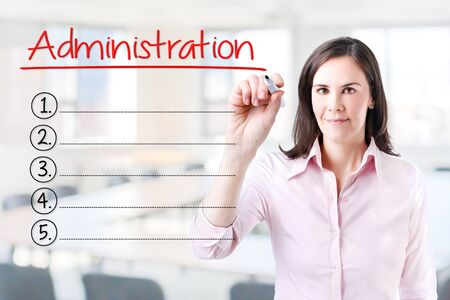 vulnerabilities: Business woman writing blank list Administration. Office background. Stock Photo