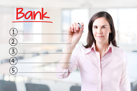 interst: Business woman writing blank bank list. Office background.