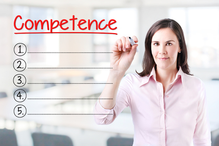 technologys: Business woman writing blank Competence list. Office background. Stock Photo
