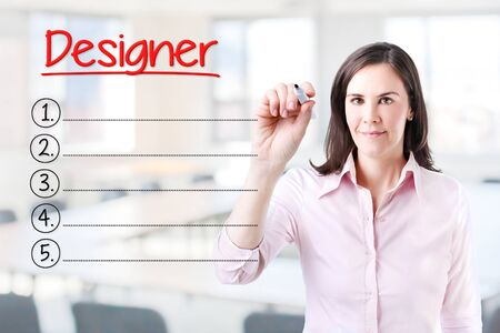 disciplines: Business woman writing blank Designer list. Office background. Stock Photo