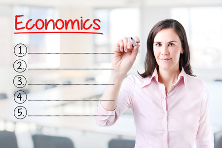 normative: Business woman writing blank list Economics. Office background. Stock Photo