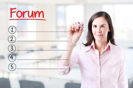 Business woman writing blank list Forum. Office background.