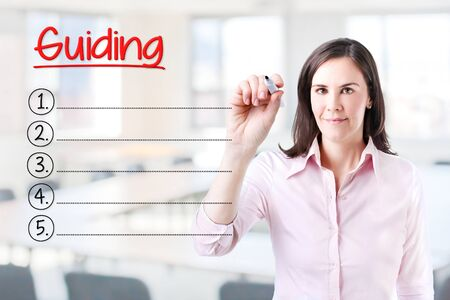 guiding: Business woman writing blank Guiding list. Office background.