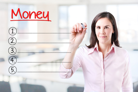 obligee: Business woman writing blank Money list. Office background.