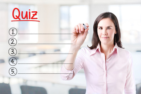 review site: Business woman writing blank Quiz list. Office background.