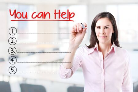raising cans: Business woman writing blank You Can Help list. Office background.