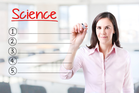 interdisciplinary: Business woman writing blank list Science. Office background. Stock Photo