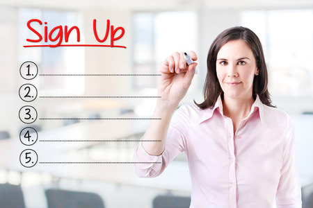 signup: Business woman writing blank Sign Up list. Office background.