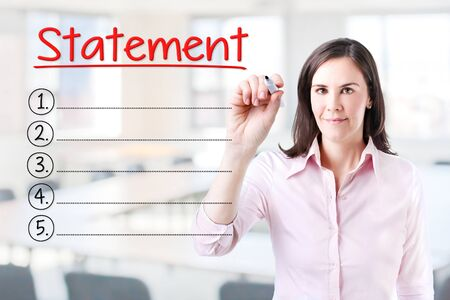 accountancy: Business woman writing blank Statement list. Office background. Stock Photo