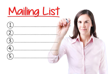 mailing: Business woman writing blank Mailing Lists list. Isolated on white. Stock Photo