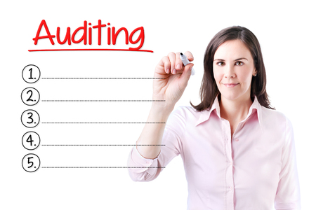 audits: Business woman writing blank Auditing list. Isolated on white.