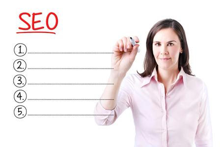 meta analysis: Business woman writing blank SEO (search engine optimization) list. Isolated on white.