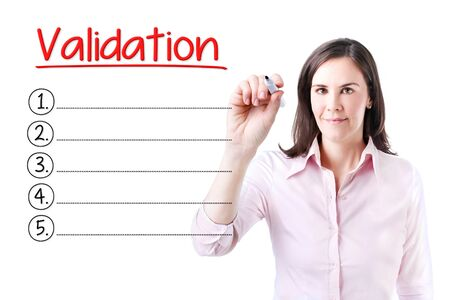 validation: Business woman writing blank Validation list. Isolated on white. Stock Photo
