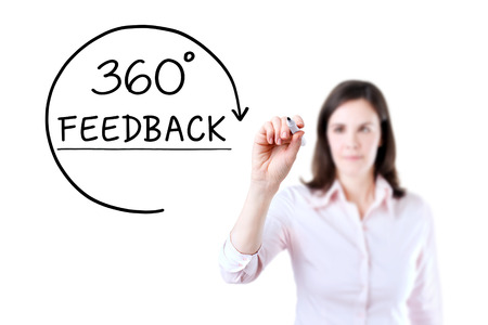 Businesswoman drawing a 360 degrees Feedback concept on the virtual screen. Isolated on white. Stock fotó