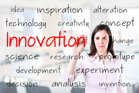 Businesswoman writing concept innovation. Office background.