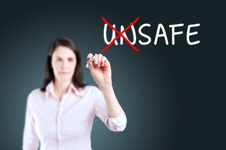 unsafe: Businesswoman Choosing Safe INSTEAD OF Unsafe. Blue background.