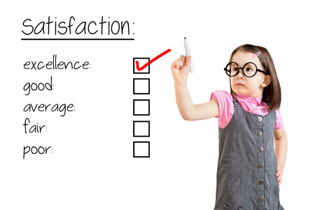 box size: Cute little girl wearing business dress and checking excellence on customer satisfaction survey form. White background.