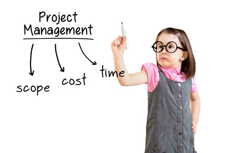project manager: Cute little girl wearing business dress and writing project management concept. White background.