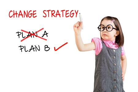 adapting: Cute little girl wearing business dress and drawing business plan strategy changing. White background. Stock Photo