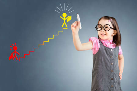 career ladder: Cute little girl wearing business dress and drawing on the career ladder concept. Blue background.
