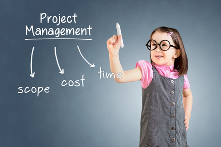 constrain: Cute little girl wearing business dress and writing project management concept. Blue background.