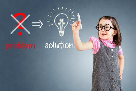 eliminate: Cute little girl wearing business dress and Eliminate problem and find solution. Blue background. Stock Photo