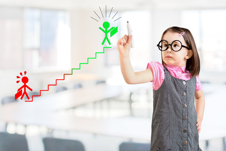 girl glasses: Cute little girl wearing business dress and drawing on the career ladder concept. Office background.